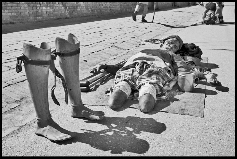 The Destitute Elderly © Dan Giannopoulos An elderly Beggar lays in the street outside Pashupati